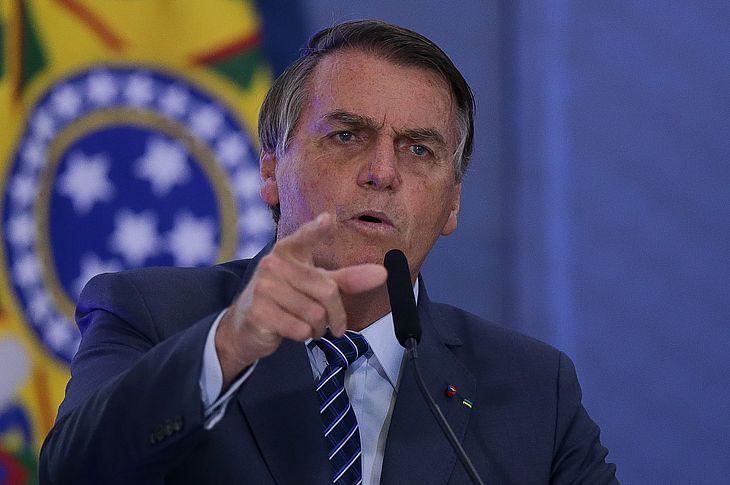 O presidente Jair Bolsonaro participa de cerimônia de abertura da Semana das Comunicações, no Palácio do Planalto